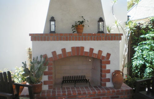 Outdoor Stucco Fireplace Installation